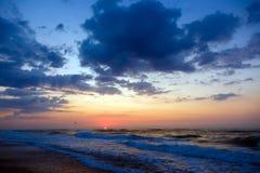Sunset on beach. Stormy sea, cloudy sky. Sunset on a beach. Stormy sea, cloudy sky Royalty Free Stock Photo