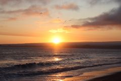 Sunset Beach. Sun going down on Californian beach Royalty Free Stock Photos