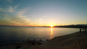 Sunset on the beach. The sun is reflected in the sea at sunset.  stock video footage