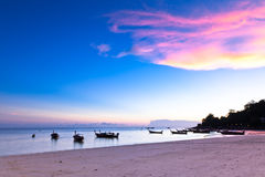 Sunset on the beach, Thailand. Traditional wooden boat on the beach of Koh Lipe Island at sunset, Thailand stock photos