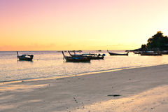 Sunset on the beach, Thailand. Traditional wooden boat on the beach of Koh Lipe Island at sunset, Thailand Royalty Free Stock Image