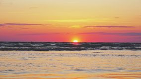 Sunset on the beach. Time-lapse shoot stock video footage