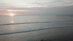 Sunset on the beach - Tranquil idyllic scene of a golden sunset over the sea, waves slowly splashing on the sand. Video. Sunset on the beach - Tranquil idyllic stock video