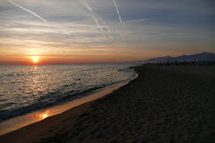 Sunset at the beach of Viareggio in Italy Royalty Free Stock Photos