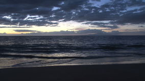 Sunset at the beach. Video of sunset at the beach stock footage