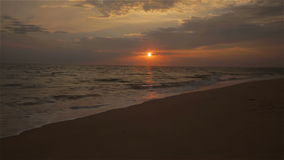 Sunset Beach Video of Waves along Sand in fron of Atlantic Ocean stock footage