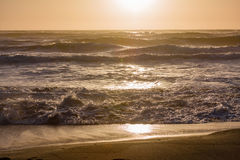 Sunset beach water waves. And sand Royalty Free Stock Images