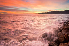 Sunset by the beach with wave in Sungai Batu. Beautiful landscape series of sunrise and sunset collection from George Town, Penang, Malaysia Royalty Free Stock Photography
