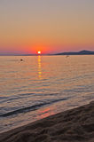 Sunset on beach at west coast of Sithonia Stock Photos