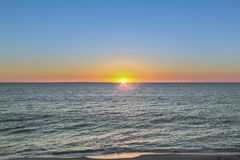 Sunset on a beach in Western Australia royalty free stock photography