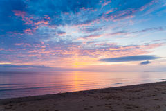 Sunset on the beach at the White sea shore. Violet sunset on the beach at the White sea shore Stock Photos