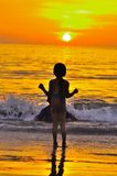 Sunset beach with young children. Young children enjoying the beach at sunset Stock Photography