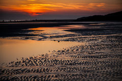 Sunset at the beach. In Zeeland, the Netherlands Stock Photos