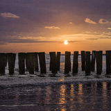 Sunset. At the beach in Zeeland, The Netherlands Stock Photo