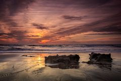 Sunset on the beaches of Cadiz. Sunsets on the beaches of Roche in Cadiz Stock Image