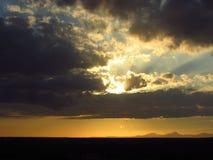 Mystic Sunset. A beautiful cloudy sunset Stock Photo