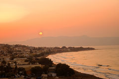 Sunset on a beautiful beach in Greece Stock Photography