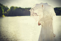 Sunset, beautiful bride on a background of water Stock Photography
