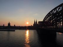 Sunset. Beautiful sunset in Cologne, on background the cathedral Stock Image