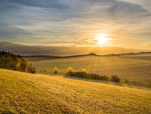 Sunset in beautiful colorful autumnal landscape Stock Photos