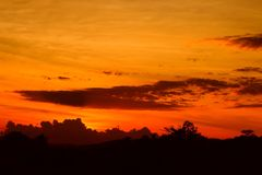 Sunset beautiful colorful landscape and silhouette tree mountain in sky twilight time.  Royalty Free Stock Photos