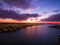Sunset with beautiful colors and lake reflections. Aerial sunset with beautiful colors in Brasilia, Brazil showing the lake and city lights royalty free stock photography