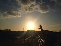 Sunset. Beautiful day to enjoy, child reaching to the sun Stock Photo