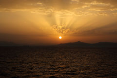 Sunset. Beautiful gold sunset in the sea Stock Images