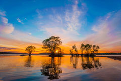 Sunset. Beautiful Sunset Landscape with reflection Stock Photo