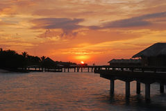Sunset with beautiful natural sky against the overwater villa Stock Photo