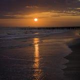 Sunset. Beautiful orange sky at the beach Royalty Free Stock Photos