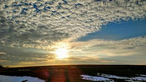 Sunset. Beautiful sunset over the hill surrounded by clouds Royalty Free Stock Photo