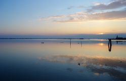 Venice, lagoon. Sunset in the beautiful and peaceful venetian lagoon, Italy stock photo