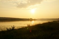 Sunset on a beautiful river in Siberia in summer stock photos