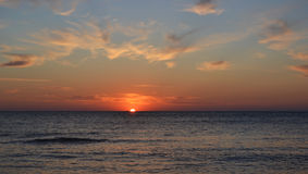 Sunset. Beautiful sunset at the seaside, a sun touches water Royalty Free Stock Images