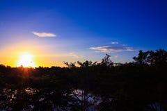 Sunset beautiful in sky dark color and silhouette tree colorfulsunset beautiful in sky dark color and silhouette tree colorful lan. Sunset beautiful in sky dark Stock Photo