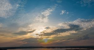 Sunset beautiful summer landscape with cloudy sky and natural lake, time-lapses.  stock footage