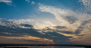 Sunset beautiful summer landscape with cloudy sky and natural lake, time-lapses.  stock video footage