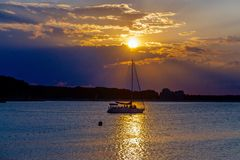 Sunset. Beautiful Sunscape and sunset. Boat on the sun path and golden sky. Picture taken in Bulgarian Black Sea resort Kiten, Bulgaria royalty free stock images