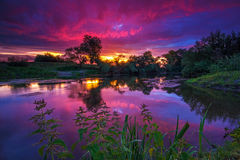 Sunset. The beauty and the colorfulness of a sunset reflecting on a river royalty free stock images