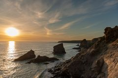 Sunset at Bedruthan Steps in Corwal, United Kingdom royalty free stock photography