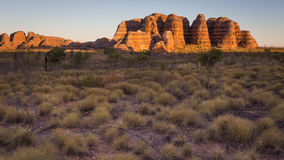 Sunset on the Beehive Domes. Landscape view of an Beehive Domes outlier illuminated by Sunset, Bungle Bungles, Kimberley, Western Australia stock photography