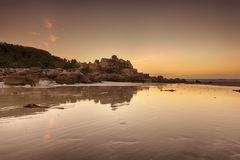 Ancient house in the rocks at Brittany beach royalty free stock photography