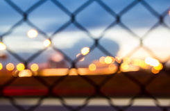 Sunset behind the barbed wire - fence with sunset background. Strange blue glow in the sky Royalty Free Stock Images