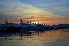 Sunset behind the boats Royalty Free Stock Photography