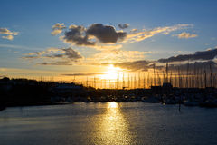 Sunset behind boats. In Howth bay, Dublin, Ireland Royalty Free Stock Photos