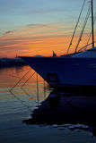 Sunset behind the boats. With a water reflection royalty free stock photography