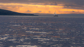 Sunset behind Brean Down in the Bristol Channel, with yacht Royalty Free Stock Photo