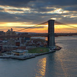 Sunset behind the Brooklyn Bridge in NYC Royalty Free Stock Photography