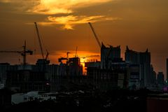 Sunset behind the building. Construction Stock Photography